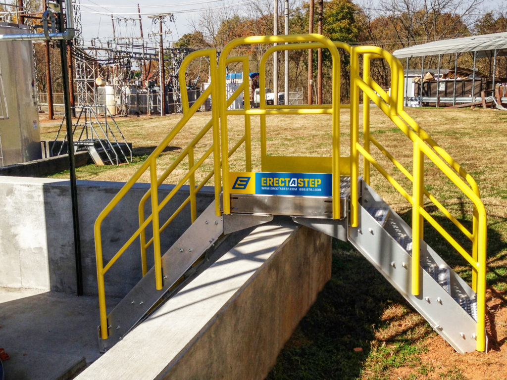 Erectastep 5-step industrial crossover stairs in use shurtape entry into tank farm area