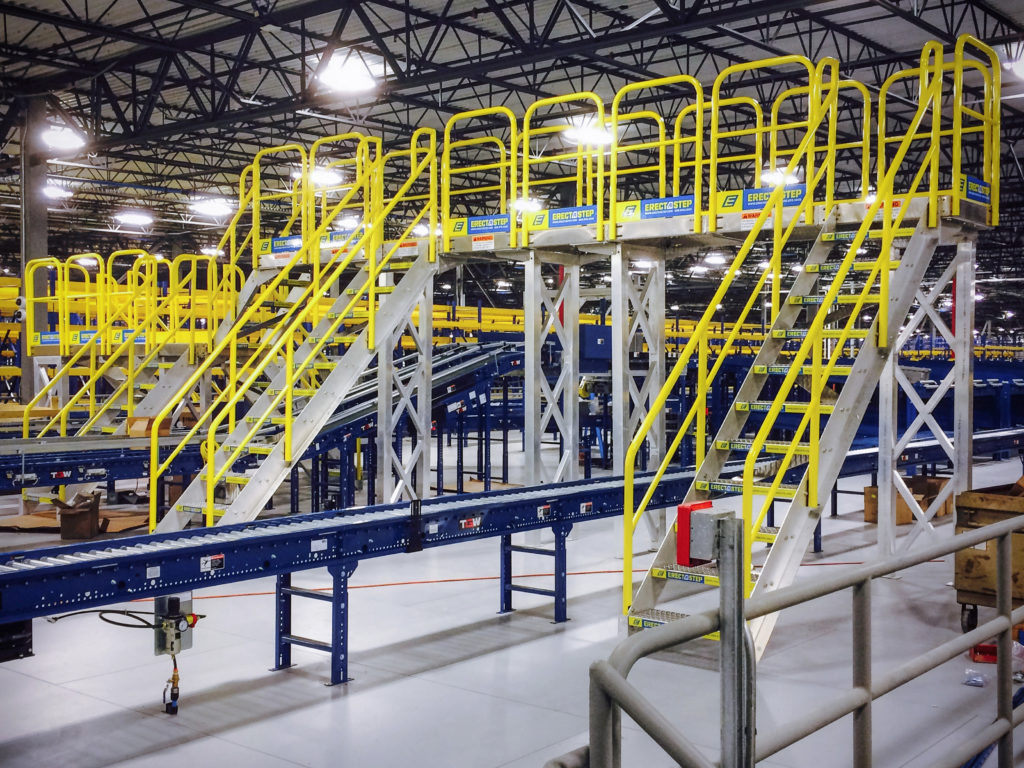 Erectastep MSC Distribution center raised walkway service platform over roller tables
