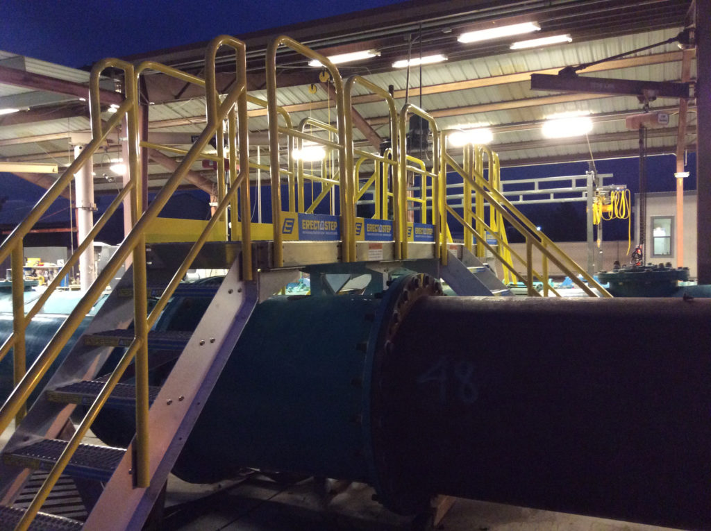 Erectastep industrial crossover stairs in Porterville facility