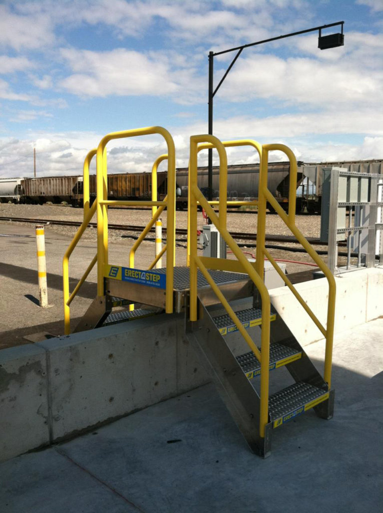 Erectastep industrial crossover stairs over cement wall