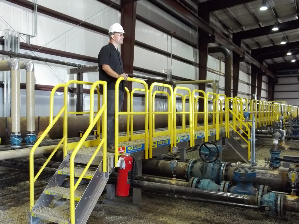 Erectastep crossover stairs over pipes in industrial facility