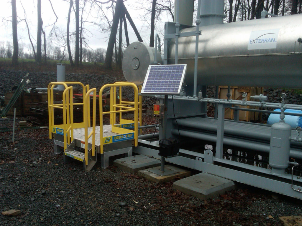 Erectastep industrial stairs and platform next to equipment