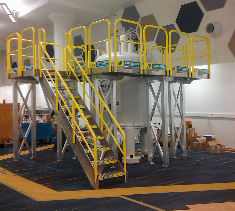Erectastep industrial stairs and access platform around around tank at Bruke Lab