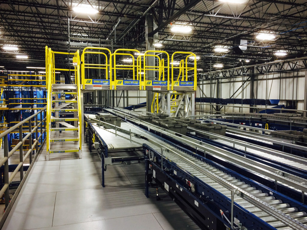 Erectastep industrial crossover stairs at distribution tables