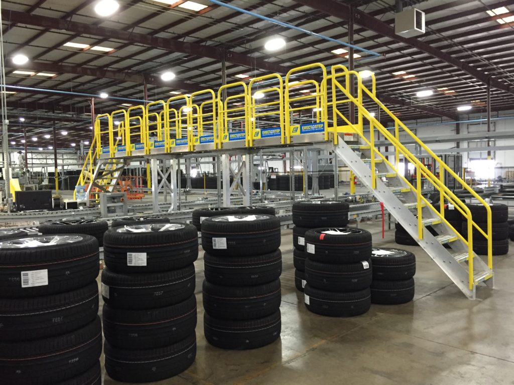 Erectastep industrial crossover stairs at tire distribution center